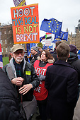 Pro and anti Brexit protesters demonstrate outside the Houses of Parliament on the day MPs voted decisively to reject Theresa May's withdrawal deal with the EU.  Westminster, London.