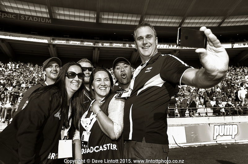 Event staff take a selfie on day two of the 2015 HSBC Sevens World Series Wellington Sevens at Westpac Stadium, Wellington, New Zealand on Saturday, 7 February 2015. Photo: Dave Lintott / lintottphoto.co.nz