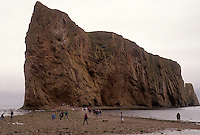Gaspe Peninsula, Perce, Quebec, Canada, Perce Rock, Gulf of St. Lawrence, People walk out to Rocher Perce (Perce Rock) at low tide on the Gulf of St. Lawrence in Perce on Gaspe Peninsula in Quebec.