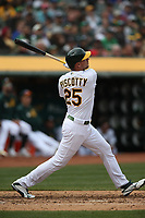 OAKLAND, CA - APRIL 4:  Stephen Piscotty #25 of the Oakland Athletics hits a home run against the Boston Red Sox during the game at the Oakland Coliseum on Thursday, April 4, 2019 in Oakland, California. (Photo by Brad Mangin)