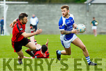 In Action KOR's Barry John Keane  gets away from Kenmare's Dara Crowley at the Castleisland Mart Senior Club Championship Kerins O'Rahilly V Kenmare at KOR GAA Ground on Sunday