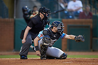 Hickory Crawdads catcher Matt Whatley (19) frames a pitch as home plate umpire Jennifer Pawol looks on during the game against the Ocelotes de Greensboro at First National Bank Field on June 11, 2019 in Greensboro, North Carolina. The Crawdads defeated the Ocelotes 2-1. (Brian Westerholt/Four Seam Images)