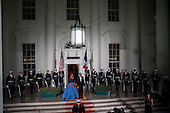 United States President Barack Obama and first lady Michelle Obama await the arrival of President Francois Hollande of France on the South Portico of the White House before the State Dinner in Hollande's honor in Washington, District of Columbia, U.S., on Tuesday, Feb. 11, 2014.  After an arrival ceremony on the South Lawn, Obama and Hollande met in the Oval Office for a policy meeting then gave a joint press conference in the East Room of the White House. <br /> Credit: Pete Marovich / Pool via CNP