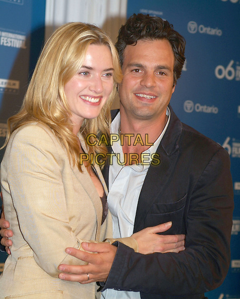 "KATE WINSLET & MARK RUFFALO.""All The Kings Men"" Press Conference during the 2006 Toronto International Film Festival held at Sutton Place Hotel, Toronto, Ontario, Canada..September 10th, 2006.Ref: ADM/BP.half length beige black.www.capitalpictures.com.sales@capitalpictures.com.©Brent Perniac/AdMedia/Capital Pictures."