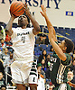 KC Ndefo #4 of Elmont, left, looks to drive past Omar Baxter #15 of Valley Stream North during the Nassau County varsity boys basketball Class A semifinals at Hofstra University on Wednesday, Feb. 24, 2016. Elmont won by a score of 77-54.