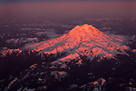 Sunset glow on Mount Rainier from sky.