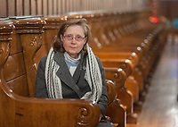 Sister Sandra Schmidt, a member of the Sisters of the Blessed Sacrament sits in the chapel above the tomb of St. Katharine Drexel at the National Shrine of St. Katharine Drexel after the last visitors have gone Saturday, December 30, 2017 in Bensalem, Pennsylvania. Drexel was an American heiress who dedicating herself to work among the American Indians and African-Americans in the western and southwestern United States. She was canonized a saint by the Roman Catholic Church in 2000. (Photo by William Thomas Cain/Cain Images)