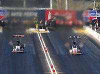 Feb 26, 2016; Chandler, AZ, USA; NHRA top fuel driver Steve Torrence (left) races alongside Doug Kalitta during qualifying for the Carquest Nationals at Wild Horse Pass Motorsports Park. Mandatory Credit: Mark J. Rebilas-