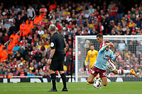 Jack Grealish of Aston Villa is fouled by Granit Xhaka of Arsenal during the Premier League match between Arsenal and Aston Villa at the Emirates Stadium, London, England on 22 September 2019. Photo by Carlton Myrie / PRiME Media Images.