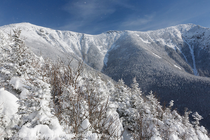 Franconia Ridge from the Old Bridle Path during the winter months in the White Mountains, New Hampshire USA. Mount Lafayette is on the left. Blowing snow can be seen in the image