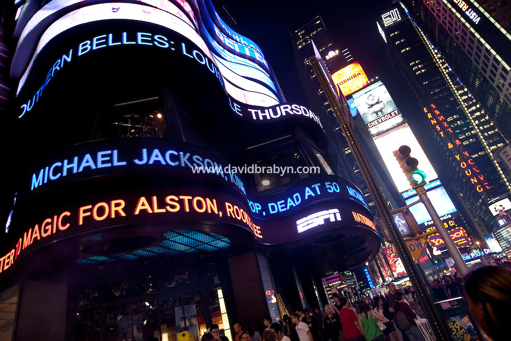 The ABC news ticker on Times Square in New York, USA, announces the death of singer Michael Jackson, 25 June 2009.
