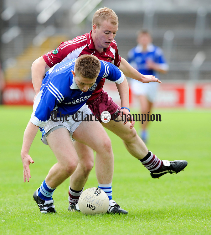Sean Chaplin of Cratloe in action against Niall Kelly of Lissycasey during their game at Cusack park. Photograph by John Kelly.