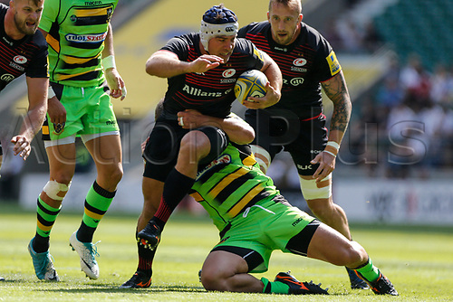 2nd September 2017, Twickenham, London, England; Aviva Premiership Rugby, Saracens versus Northampton; Schalk Brits of Saracens is tackled by Alex Waller of Northampton Saints