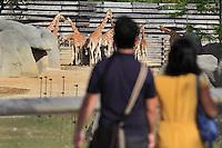 Visitors walking towards the giraffes area, Zone Sahel-Soudan of the new Parc Zoologique de Paris or Zoo de Vincennes, (Zoological Gardens of Paris or Vincennes Zoo), which reopened April 2014, part of the Museum national d'Histoire naturelle (National Museum of Natural History), 12th arrondissement, Paris, France. Picture by Manuel Cohen