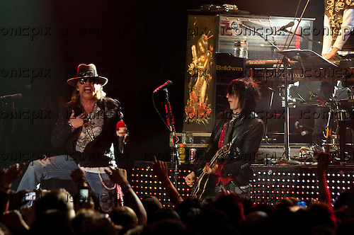 GUNS N' ROSES - Axl Rose and guitarist Richard Fortus performing live in at the Palladium in Hollywood, CA USA - March 9, 2012. Photo © Kevin Estrada / Iconicpix