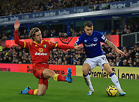 23rd  November 2019; Goodison Park , Liverpool, Merseyside, England; English Premier League Football, Everton versus Norwich City; Todd Cantwell of Norwich City slides in to tackle Lucas Digne of Everton - Strictly Editorial Use Only. No use with unauthorized audio, video, data, fixture lists, club/league logos or 'live' services. Online in-match use limited to 120 images, no video emulation. No use in betting, games or single club/league/player publications