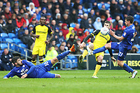 Callum Paterson of Cardiff City and Craig Bryson challenge Luke Murphy of Burton Albion for the ball during the Sky Bet Championship match between Cardiff City and Burton Albion at the Cardiff City Stadium, Wales, UK. Friday 30 March 2018