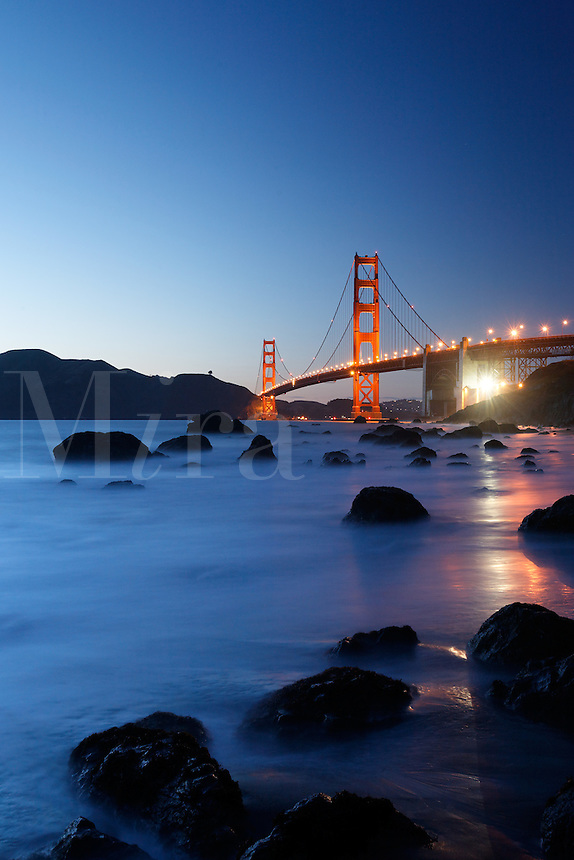 Golden Gate Bridge and surf on Marshall Beach rocks, Golden Gate National Recreation Area, San Francisco, California, USA, North America