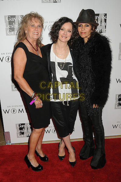 """Marluce Perry, Sara Gilbert, Linda Perry.LA Gay & Lesbian Center's """"An Evening With Women"""" 2013 held at the Beverly Hilton Hotel, Beverly Hills, California, USA, 18th May 2013..full length black white fur jacket coat hat  .CAP/ADM/BP.©Byron Purvis/AdMedia/Capital Pictures"""