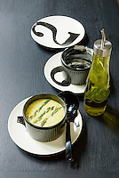 Asparagus and tarragon en cocotte served in stylish black and white china