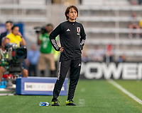 ORLANDO, FL - MARCH 05: Asako Takadura of Japan watches her team during a game between Spain and Japan at Exploria Stadium on March 05, 2020 in Orlando, Florida.