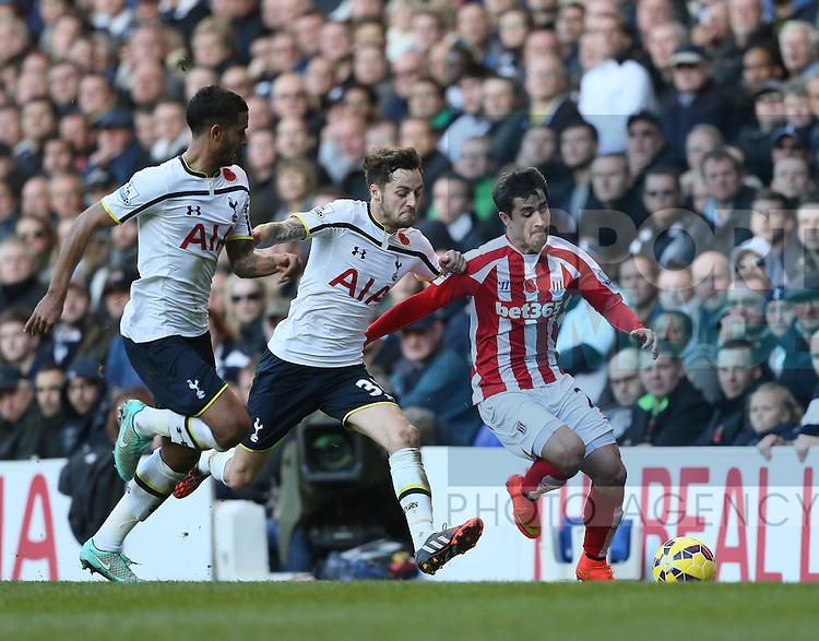 Tottenham's Ryan Mason tussles with Stoke's Bojan Krkic<br /> <br /> - Barclays Premier League - Tottenham Hotspur vs Stoke City- White Hart Lane - London - England - 9th November 2014  - Picture David Klein/Sportimage