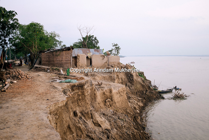 Half of the house of Sulekha Mondal swept away in erosion on September 2014. According to villagers last year her house was 50 mts away from Ganges. Kulidihar village, Murshidabad District, West Bengal, India.