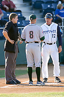 Everett AquaSox coach Mike Kinkade #12, Boise Hawks manager Mark Johnson #8 and home plate umpire Matthew Czajak meet before a game between the two clubs at Everett Memorial Stadium in Everett, Washington on July 30, 2011.  (Ronnie Allen/Four Seam Images)
