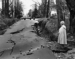 Mayor Donna Warkoski views a washout on Minor Road in Plymouth after flooding in 1987.