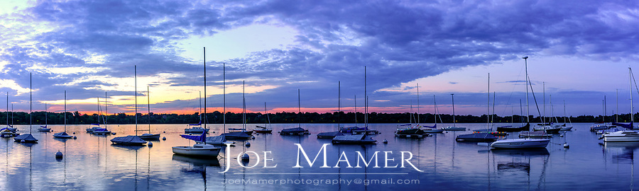 Sailboats at dawn on Lake Harriet in Minneapolis, Minnesota.