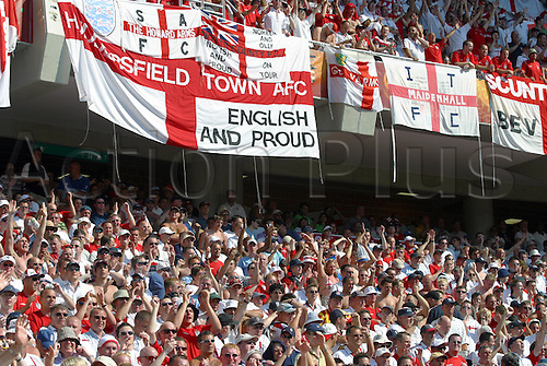 17 June 2004: England supporters and their St. George flags pack the stands during the Euro 2004 Group B game between England and Switzerland played at the Estadio Cidade de Coimbra, Coimbra, Portugal. England won the game 3-0. Photo: Neil Tingle/Action Plus...040617 football soccer UEFA European Championships crowd crowds supporters fans spectators
