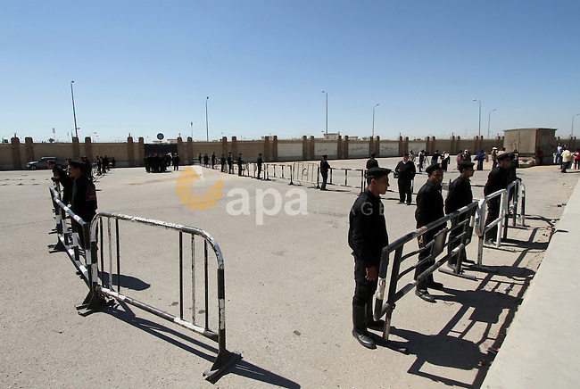 Egyptian security forces stand guard the police academy in Cairo, Egypt, on Feb. 19, 2014. Photo by Mohammed Bendari