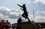 A young Sunderland fan touches the Bob Stokoe statue. Sunderland 2 Portsmouth 1, 17/08/2019. Stadium of Light, League One. Photo by Paul Thompson.