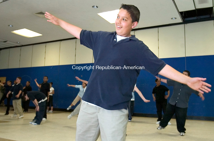 WATERBURY, CT. 25 April 2007-042507SV10--Zulfi Jashari, 12, and his classmates learn a few dance moves during a class with the Nai Ni Chen Dance Company at Wallace Middle Schoool in Waterbury Wednesday.<br /> Steven Valenti Republican-American