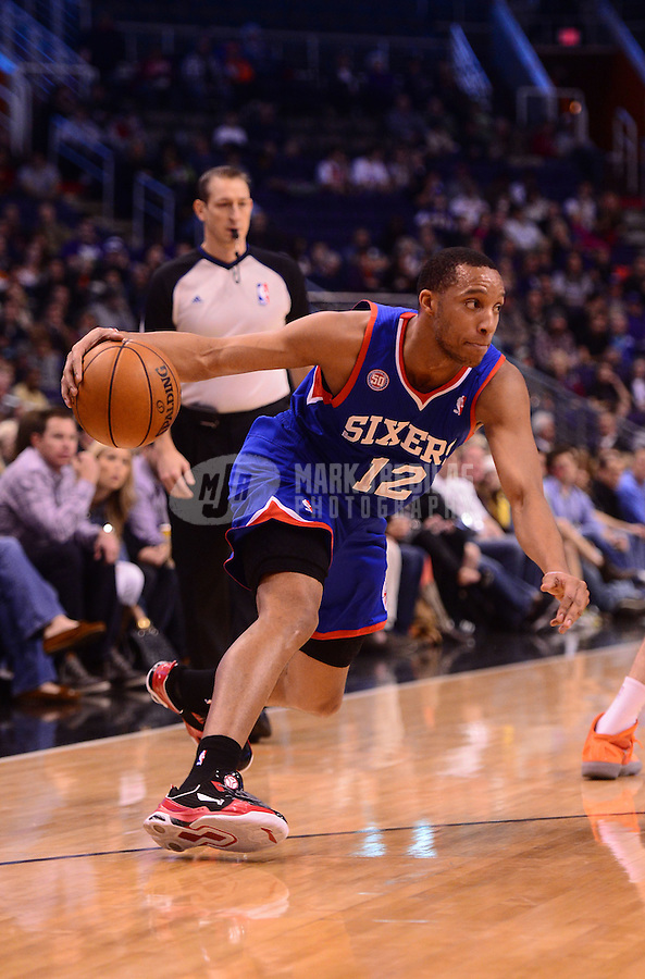 Jan. 2, 2013; Phoenix, AZ, USA: Philadelphia 76ers forward Evan Turner controls the ball in the first quarter against the Phoenix Suns at the US Airways Center. Mandatory Credit: Mark J. Rebilas-USA TODAY Sports
