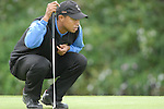 Ryder Cup 206 K Club, Straffan, Ireland..American Ryder Cup team player Tiger Woods lines up his putt on the 4th green during  the  morning fourballs session of the 2nd day of the 2006 Ryder Cup at the K Club in Straffan, Co Kildare, in the Republic of Ireland, 23 September 2006...Photo: Eoin Clarke/ Newsfile.