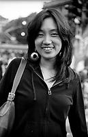 """milano, manifestazione euro mayday parade 2007. """"qual'è la tua condizione economica/lavorativa?""""  HANAKO TSUSHIMA, 28 anni, giapponese. Studente di biologia. """"Non so se definirmi come studente..  ho una borsa di studio per il dottorato in oncologia molecolare, in un instituto privato (ifom-ieo). Sono una ricercatrice (borsista), ma non ho un contratto, a parte la lettera dall' instituto che mi garantisce la borsa di studio, che viene rinnovato ogni anno per quattro anni.....Per quanto riguarda se mi basta la borsa per essere autosufficente...direi che danno giusto per sopravivere la vita quotidiana.. """".Hanako lavora anche occasionalmente in una gelateria..""""Comunque, dopo il dottorato vorrei continuare in ambiente di ricerca, come post-doctorate (altri anni come borsista..), o come """"scientific writer""""......In italia la situazione per ricercatori e' veramente fatto male sopratutto per quanto.vieni pagato. Ma il livello di ricerca dipende da ogni gruppo, e dipende anche da argomenti. La borsa di studio e' molto meglio nei paesi per esempio usa, inghilterra, giappone e anche svizzera...ma secondo me la ricerca per se non e' fatto male. penso che ci sono tanti bravi scienziati italiani. La curiosita' che corre nella sangue italiano aiuta forse..(?!)"""" --- milan, euro mayday parade 2007 demonstration. """"How is your economic and working condition?""""  HANAKO TSUSHIMA, 28, japanese, student in biology. """"i don't know if i can define myself a student...I have an aid grant for a doctorate in molecular oncology in a private institute (ifom-ieo). I'm a researcher but I don't have any contract, apart of the letter from the institute which assures me the aid grant and that is renewed every year for four years. ...in regards to the aid grant, if it's enough to be self-sufficient....i would say they give just enough to survive daily life.."""".Hanako also works occasionally in an ice-cream parlour..""""Anyway, after the doctorate I'd like to continue in the field of research, as post-doctor"""