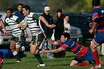 J. Leota gets through the tackle of A. Te Pou. Counties Manukau Premier Club Rugby, Ardmore Marist vs Manurewa played at Bruce Pulman Park, Papakura on the 10th of June 2006. Ardmore Maris won 18 - 11.