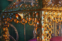 Detail of the metalwork in circles on the reliquary of Saint Pierre Aumaitre, with a fragment of his femur on a pink cushion, by Cat-Berro, Orleans, in the Bell tower room themed 'Le Merveilleux' or The Supernatural, first floor, in Le Tresor de la Cathedral d'Angouleme, in Angouleme Cathedral, or the Cathedrale Saint-Pierre d'Angouleme, Angouleme, Charente, France. The 12th century Romanesque cathedral was largely reworked by Paul Abadie in 1852-75. In 2008, Jean-Michel Othoniel was commissioned by DRAC Aquitaine - Limousin - Poitou-Charentes to display the Treasure of the Cathedral in some of its rooms, which opened to the public on 30th September 2016. Picture by Manuel Cohen. L'autorisation de reproduire cette oeuvre doit etre demandee aupres de l'ADAGP/Permission to reproduce this work of art must be obtained from DACS.