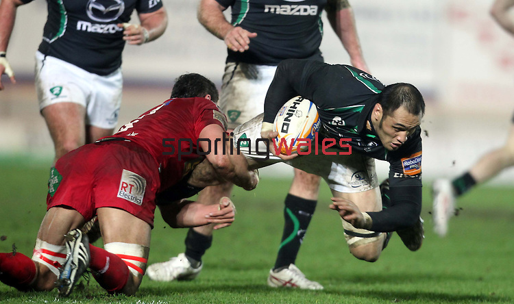 Aaron Shingler tackles George Naoupu..RaboDirect Pro12.Scarlets v Connacht.02.03.12.©STEVE POPE