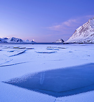 Ice on Haukland beach in winter, Vestvagøy, Lofoten islands, Norway