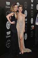 SANTA MONICA, CA - JANUARY 06: Actress Amber Heard (R) and sister Whitney Heard arrive at the The Art Of Elysium's 11th Annual Celebration - Heaven at Barker Hangar on January 6, 2018 in Santa Monica, California.<br /> CAP/ROT/TM<br /> &copy;TM/ROT/Capital Pictures