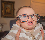 Grandson in in grandpas glasses.