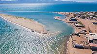 Isla Tiburón, Shark Island<br /> <br /> Aerial view of the community of Punta Chueca where the population of the Seri ethnic group lives. Punta Chueca, Socaaix in the Seri language, is a locality in the Mexican state of Sonora. It is located about 20 kilometers north of the town of Bahía de Kino being a port in the Gulf of California, Punta Chueca is the point of the mainland closest to Isla Tiburón, from which it is separated only by the Estrecho del Infiernillo.<br /> <br /> (Photo: Luis Gutierrez)<br /> <br /> <br /> Vista aérea de la comunidad de Punta Chueca donde vive la población de la etnia Seri.  Punta Chueca, Socaaix en idioma seri, es una localidad del estado mexicano de Sonora.  Se encuentra a unos 20 kilómetros al norte de la población de Bahía de Kino siendo un puerto en el Golfo de California, Punta Chueca es el punto de tierra firme más cercano a la Isla Tiburón, de la que la separa únicamente el Estrecho del Infiernillo.<br /> <br /> (Photo:Luis Gutierrez)
