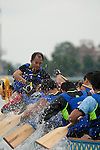 Vancouver, Canada, Aug 8th 2009. World Police and Fire Games, Dragon Boat Competition.  The Mixed Open 10 team from the Hong Kong Police Dragon Boat Team digs hard in their first heat.  They placed third in this race.  Photo by Gus Curtis