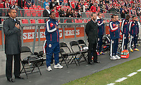 14 April 2012: The coaching and training staff of Chivas USA stand for the national anthems during the opening ceremonies in a game between Chivas USA and Toronto FC at BMO Field in Toronto..Chivas USA won 1-0..