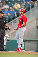 Springfield Cardinals infielder Evan Mendoza (4) laughs while waiting for home plate umpire Luis Hernandez (left) to review a call with the umpire crew on May 16, 2019, at Arvest Ballpark in Springdale, Arkansas. (Jason Ivester/Four Seam Images)