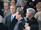 "United States President-elect George W. Bush gives Vice President Al Gore a ""gotcha"" look as United States President Bill Clinton enjoys the last minutes of his presidency at the U.S. Capitol in Washington, D.C. on January 20, 2001.  Bush defeated Gore in a hard fought election where Gore won the popular vote but lost to Bush who captured the Electoral College by winning in Florida. .Credit: Arnie Sachs / CNP"
