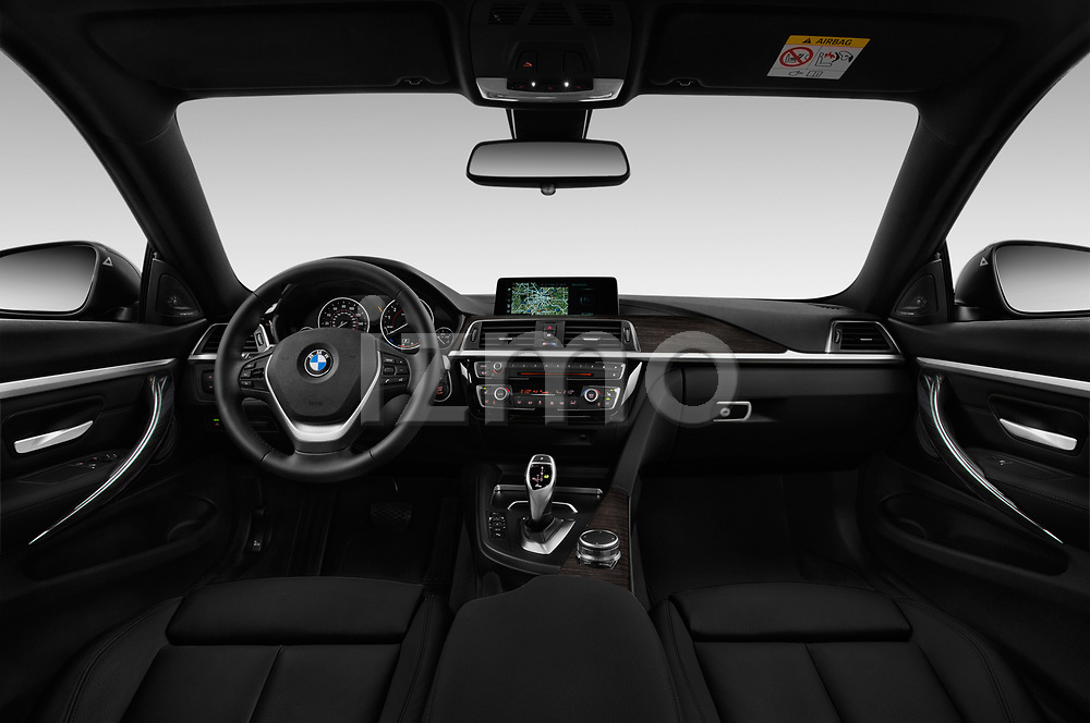 Stock photo of straight dashboard view of a 2019 BMW 4 Series 430i Coupe 2 Door Coupe