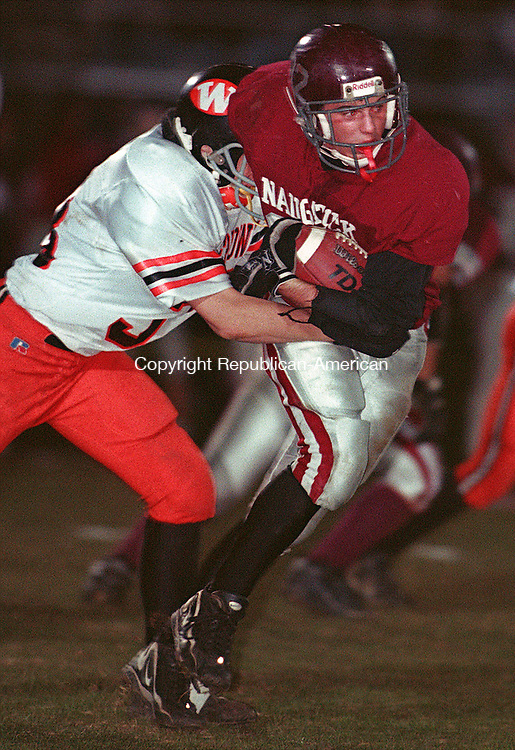 NAUGATUCK, CT 11/06/98--1106CA02.tif (left to right) #33 from Watertown High School attempts to tackle #32 Kyle Wells from Naugatuck, during last evenings football game at Naugatuck High School.--CRAIG AMBROSIO staff  / STAND ALONE PHOTO  (Filed in Scans/Scan-In)